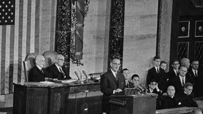 """President Johnson delivering his """"War on Poverty"""" speech in1964. Did HE say it? (Associated Press)"""