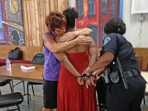 Volunteer Helen Seybert, left, hugs a woman arrested in a prostitution sweep this week. The woman, who called herself ´Jojo,´ was offered rehab in lieu of charges as part of a new initiative between police, prosecutors and community members. Five women opted to go to rehab, though Jojo was not one of them. Staff photo by Julia Terruso