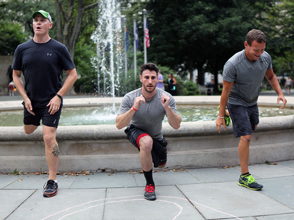 Justin D´Ancona (center) works out during a Relentless Fitness Spartan Race prep class in Washington Square Park in Philadelphia. (Stephanie Aaronson / Philly.com)