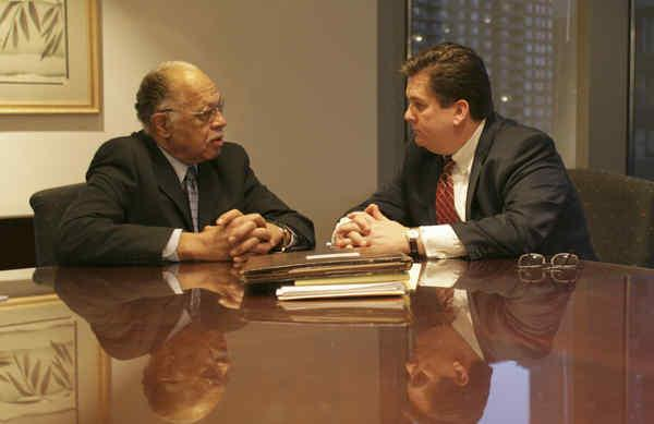 Dr. Kermit B. Gosnell talks to his attorney, William J. Brennan.