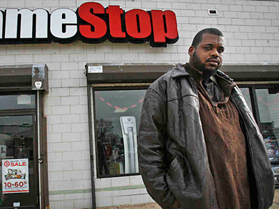 Kevin Hutchinson, 32, of North Philadelphia, was fired from GameStop after a background check revealed a crime he did not commit. (Alejandro A. Alvarez/Staff)