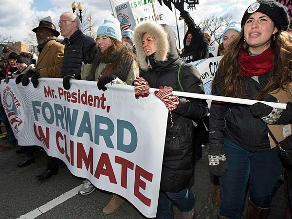 Among about 35,000 in Washington protesting climate change is environmentalist Bill McKibben (center). About 500 activists from the Philadelphia area joined the protest Sunday outside the White House.