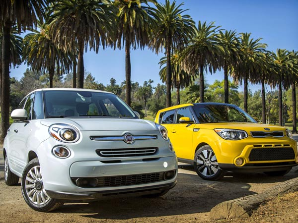 """The all-new Fiat 500L, left, and the redesigned Kia Soul are in a quirky """"toaster"""" class of subcompact cars that also includes the Nissan Cube and Juke, and the Scion xB. (Ricardo DeAratanha/Los Angeles Times/MCT)"""