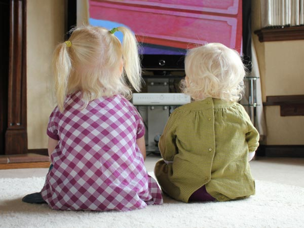 Sisters watch TV.