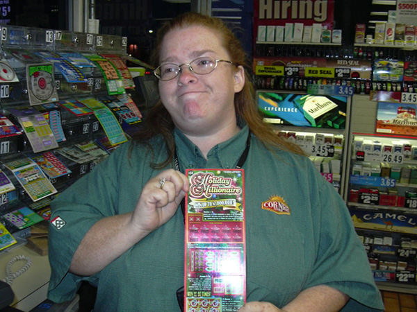 Lisa Rose, an assistant manager at the Diamond Shamrock store  in Kingsville, Texas, that sold the legendary Joan Ginther her first huge instant prize, a $2 million winner, in 2006. Rose holds a ticket from the game Ginther won. (Photo by Mary Ann Cavazos/Corpus Christi Caller-Times)