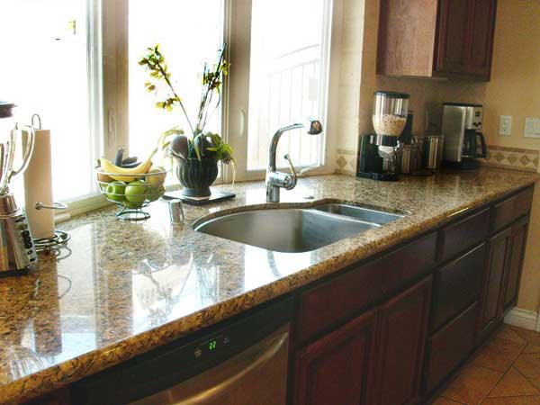 """""""Under mount""""-style sinks are usually locked in under the counter, so in most cases the countertop would be removed along with the sink."""