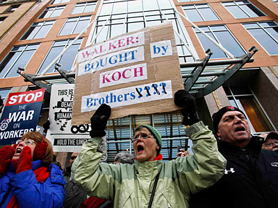 Union supporters demonstrate in front of Koch Industries HQ in Madison, Wisc., last week. (Associated Press)