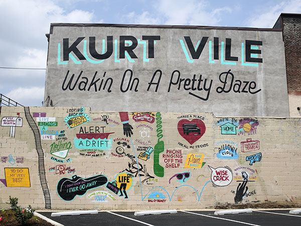The white paint has been removed from the Kurt Vile mural on Front Street in Fishtown on July 3, 2014. (Stephanie Aaronson/Philly.com)