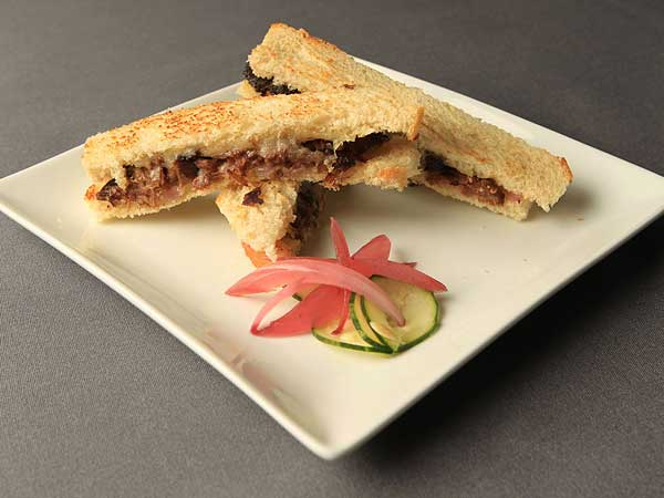 A highlight at Caleb's American Kitchen: Grilled cheese updated with shreds of tender braised short rib.