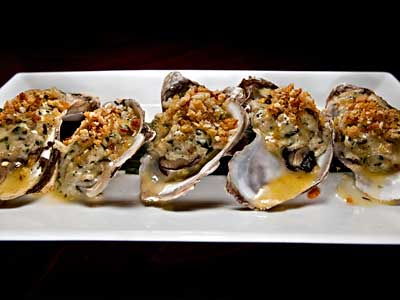 Roast oysters with crabmeat stuffing, saffron and thyme. (DAVID M WARREN / Staff Photographer)