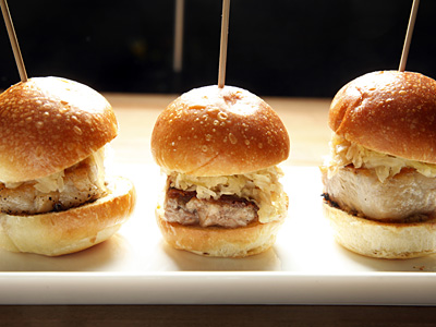 The meat in the pork belly sliders is braised to tenderness, crisped, and layered with house-cured kraut and homemade mustard. (Pork Belly Sliders at The Corner Restaurant in Philadelphia. (Laurence Kesterson / Staff Photographer)