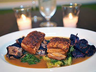 Braised Berkshire pork belly, a tender, juicy stack with savory depth. Chef Lee Styer's enterprise has added diversity and style to the East Passyunk scene. (SHARON GEKOSKI-KIMMEL / Staff Photographer)