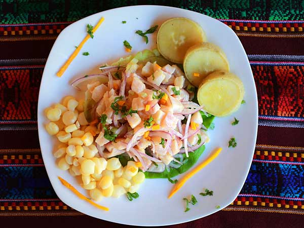 Ceviche requires a two-hour prep. Tilapia is diced and marinated in lime, bitter orange juice, ginger, aji spice.