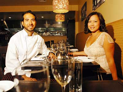Melograno now makes its trattoria magic in a long, butter-colored, rustic dining room. Left, chef Gianluca Demontis and Rosemarie Tran, the owners.