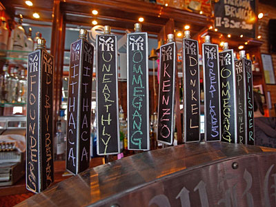 Beer taps with handwritten names at the South Philadelphia Taproom at Mifflin and South Hicks. The bar has 14 fresh taps and a 70-bottle list. (DAVID M WARREN / Staff Photographer)