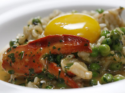 One full-on luxury among otherwise homey dishes is the lobster risotto topped with egg yolk and truffle sauce. (MICHAEL S. WIRTZ / Staff Photographer)