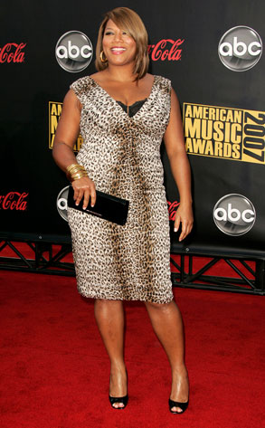 Queen Latifah wearing a dress from her fashion collection on HSN