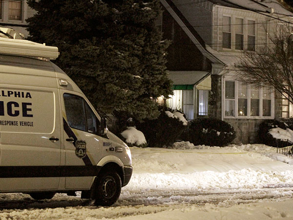 The Philadelphia Police Crime Scene Unit sits outside of a house on Martons Mill Road, where police found three men dead at about 3:30 pm on February 13; 2014. ( ELIZABETH ROBERTSON / Staff Photographer )
