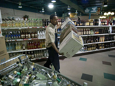 LCB employee Larry Smith stocking shelves in 2005 at the State Store in Franklin Mills, one of 613 that Pennsylvania operates. (Jonathon Wilson/ File Photograph)