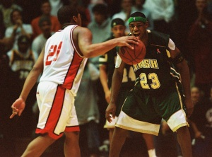 Lebron James, playing for St. Vincent-St. Mary High School of Akron, Ohio, guards Strawberry Mansion&acute;s Maureece Rice at<br />the Palestra on Sunday, December 22, 2002.  (Jennifer Midberry/Daily News)