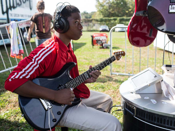 Donald Patterson, an 11th grader at Martin Luther King High School, plays guitar at the High School Nation tour stop on October 4, 2013. (Colin Kerrigan / Philly.com)