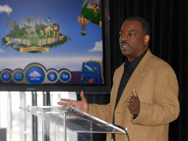 """FILE- This June 19, 2012 file photo shows LeVar Burton introducing the all new Reading Rainbow adventure app to the media, publishers and parents at the """"Reading Rainbow Relaunch"""" event in New York.  Burton´s campaign to bring """"Reading Rainbow"""" to the online masses is off to an impressive start. It reached its fundraising goal within hours of its launch on Wednesday, May 28, 2014, on Kickstarter, according to the fundraising website. (AP Photo/Reading Rainbow, file)"""