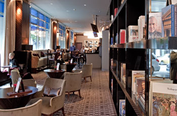 The lounge, complete with bookshelves, at Liberte in the Sofitel. (Photo: DAVID M WARREN / Staff)