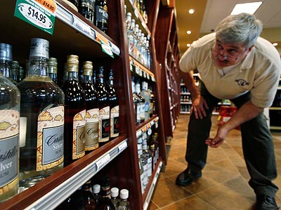 A review published in the American Journal of Preventive Medicine, found that privatization of liquor sales resulted in a median increase in alcohol sales of 44 percent. (AP Photo/Elaine Thompson)