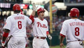 Chase Utley (center) is congratulated by Ryan Howard and Shane Victorino after Utley hit a two-run home run to put the Phillies up 7-3.