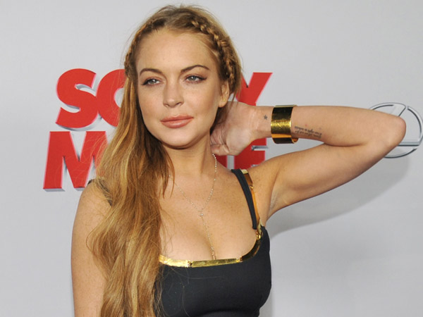 """Lindsay Lohan, a cast member in """"Scary Movie V,"""" poses at the Los Angeles premiere of the film at the Cinerama Dome on Thursday, April 11, 2013 in Los Angeles. (Photo by Chris Pizzello/Invision/AP)"""