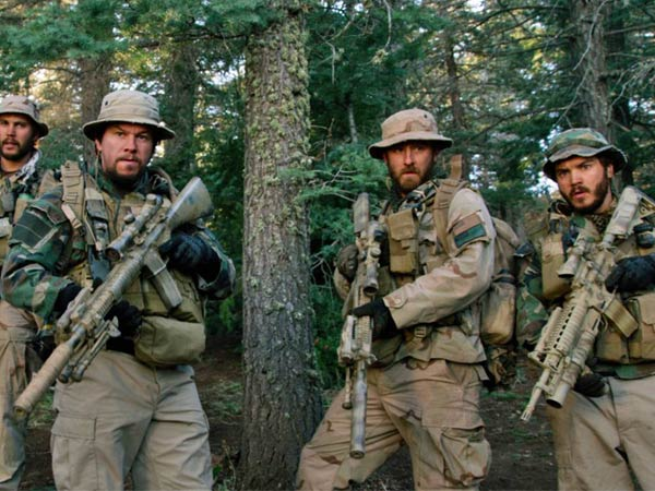 "This photo released by Universal Pictures shows, from left, Taylor Kitsch, as Michael Murphy, Mark Wahlberg as Marcus Luttrell, Ben Foster as Matt Axelson, and Emile Hirsch as Danny Dietz in a scene from the film, ""Lone Survivor."" In the age of the superhero, the movies´ most reliable real-life hero has been the Navy SEAL. ""Lone Survivor,"" is the latest in a string of films, including ""Zero Dark Thirty"" and ""Act of Valor"" to honor the Navy´s special operations force with as much faithfulness as the filmmakers could muster. (AP Photo/Universal Pictures)"