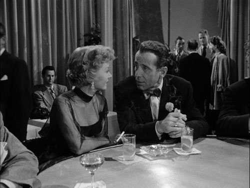 "Gloria Grahame and Humphrey Bogart at the piano bar in ""In a Lonely Place"""