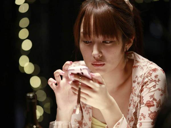 SRALIK -- Akiko (Rin Takanashi) in Abbas Kiarostami's LIKE SOMEONE IN LOVE. Copyright Eurospace. A Sundance Selects release.