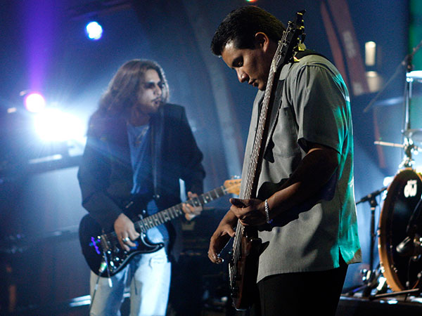 Henry Garza, right, and Jojo Garza, of the music group Los Lonely Boys, perform with the band as part of Nissan Live Sets on Yahoo! Music in Los Angeles on Thursday, July 24, 2008. (AP Photo/Matt Sayles)