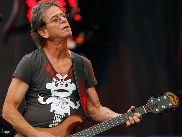 Lou Reed performs at the Lollapalooza music festival, in Chicago. Punk-poet, rock legend Lou Reed died of a liver-related ailment, his literary agent said Sunday, Oct. 27, 2013. He was 71. (AP Photo/John Smierciak, File)