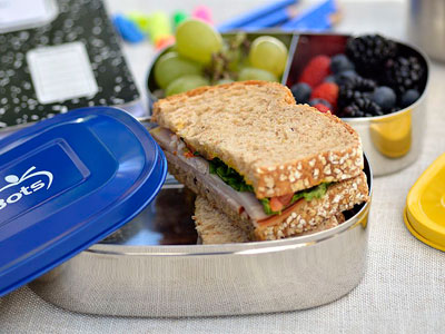 Who doesn't love variety at a meal?  Fill a bento lunch box container with mini sandwiches, cut vegetables and dip, and sliced fruits for a well-rounded meal kids are sure to love.