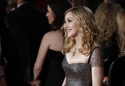 Madonna arrives at the 69th Annual Golden Globe Awards Sunday, Jan. 15, 2012, in Los Angeles. (AP Photo/Matt Sayles)