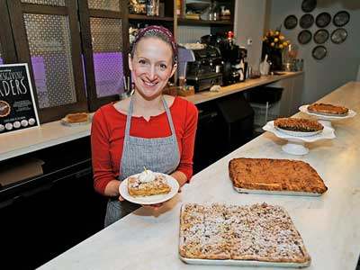 At Magpie Artisan Pie Boutique on South Street in Philadelphia, Holly Ricciardi has made a pear ginger oatmeal crunch pie. There is also a caramel apple pie and pecan pie behind the pear ginger pie slab (front). (SHARON GEKOSKI-KIMMEL / Staff Photographer)