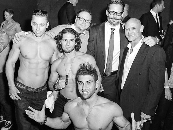 Joe Manganiello (rear, with glasses) poses with the La Bare dancers at the premiere of his new film about male strippers.