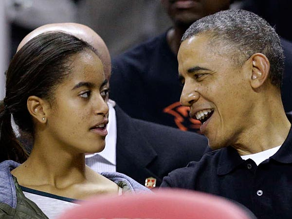 Malia Obama and her father attending an NCAA basketball game between Maryland and Oregon State in College Park, Md., in November.