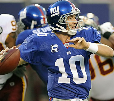 Eli Manning helped the Giants beat the Redskins, 16-7, in the NFL opener Thursday night. (Bill Kostroun/AP)