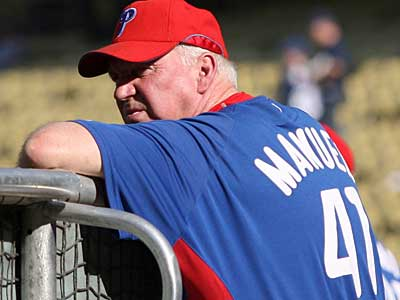 Phillies´ Manager Charlie Manuel watches his team take batting practice before the Phillies play the Los Angeles Dodgers in game one of NLCS at Dodger Stadium on Thursday. (Yong Kim / Staff Photographer)
