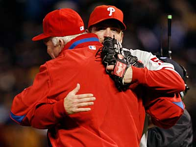 Charlie Manuel hugs closer Brad Lidge after Lidge secured the victory in Game 4 of the NLDS. (AP Photo/David Zalubowski)