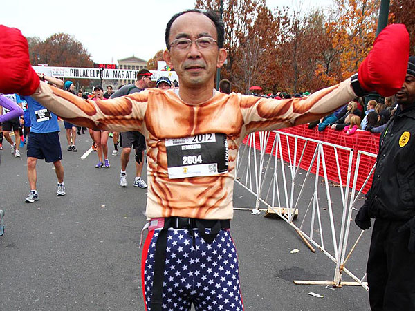 "Kenichiro Maemura, of Novi, Michigan at the 2012 Philly Marathon finish line: ""Adrian!! I did it!"" (Ning Shao/Philly.com)"