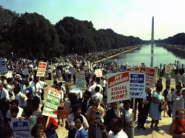 "People carry civil rights signs as they gather in Washington, D.C. before Martin Luther King Jr.´s ""I Have a Dream"" speech on Aug. 28, 1963. (AP Photo)"