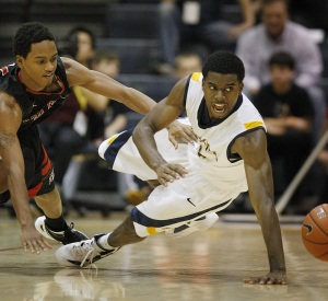 Drexel&acute;s Frantz Massenat, right, and St. Francis&acute; Stephon Whyatt<br />dive for a loose ball in a December 31, 2011 game at the Daskalakis Center.  (MICHAEL S. WIRTZ / staff Photographer )