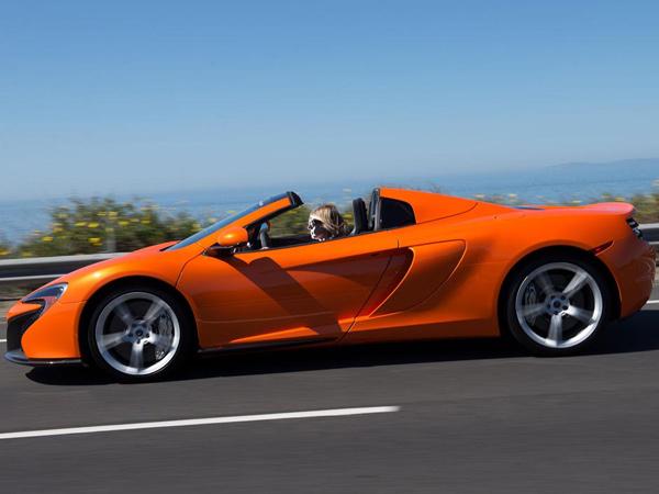 Susan Carpenter test-drives the new McLaren 650S on Pacific Coast Highway in Newport Beach, Calif., on April 7, 2014. (Eugene Garcia/Orange County Register/MCT)