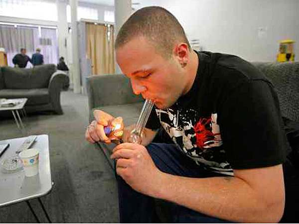 2009 File photo: Samuel Bagdorf of San Francisco lighting a marijuana pipe yesterday at a medical-marijuana clinic in that city.