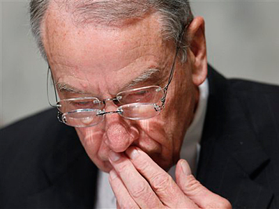 In this Oct. 13, 2009, photo the Senate Finance Committee&acute;s ranking Republican Sen. Charles Grassley, R-Iowa, wears two pairs of glasses while reading during the committee&acute;s hearing regarding health care reform. (AP Photo/Charles Dharapak, File)<br />