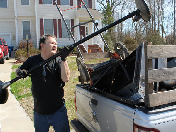 Jim Ridenhour loads a lamp from a neighbor to carry to a recycler in Carrollton, Va., on April 201, 2014. Ridenhour has been earning extra money by scrapping but has found the increase in metal thefts, especially copper wire, makes it harder for legitimate scrappers. (Nicole Paitsel/Newport News Daily Press/MCT)